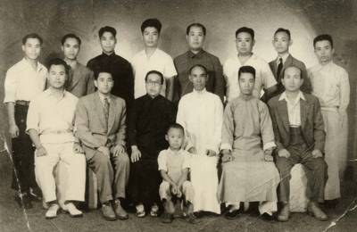 Grand Master Wang Xiang Zhai seated with his students